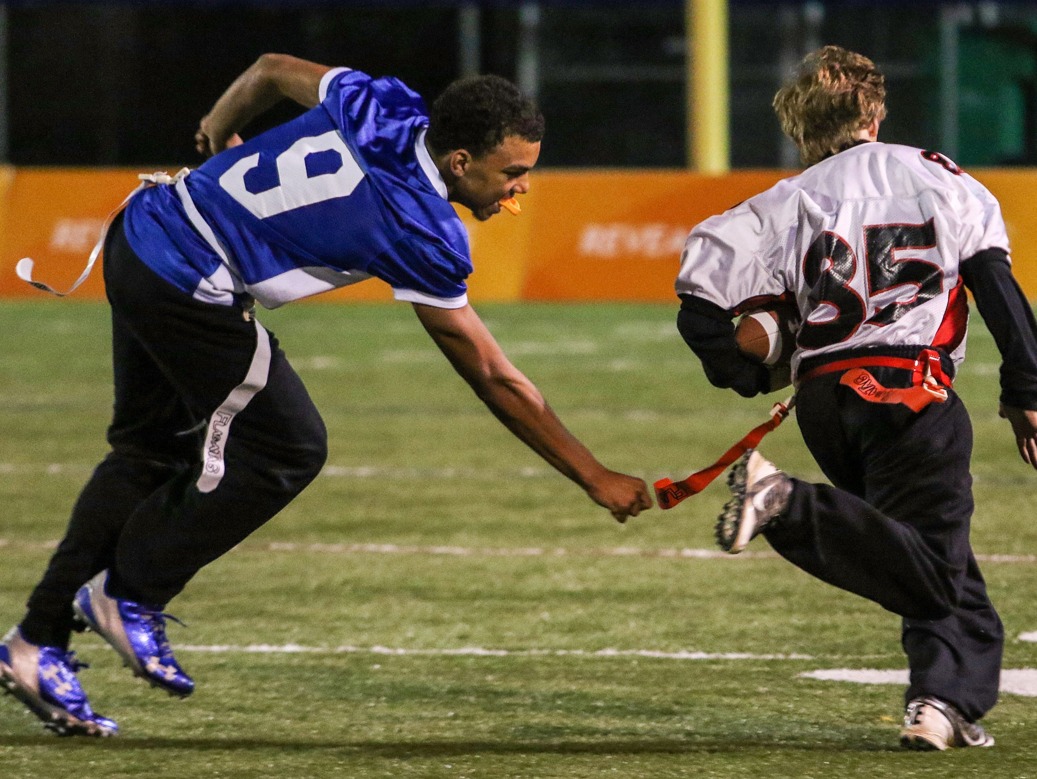 William Penn Unified Football athlete Sam Hensley is too speedy for Middletown Unified Football partner Shane Wilkins, who couldn't quite reach the flag.