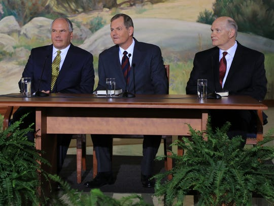 Elders Ronald A. Rasband, Gary E. Stevenson and Dale G. Renlund, all new members of the Quorum of the Twelve Apostles of The Church of Jesus Christ of Latter-day Saints, listen to questions during an Oct. 3 press conference in Salt Lake City.