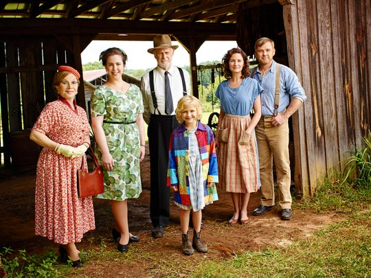 "The cast of ""Dolly Parton's Coat of Many Colors, lef to right, are Stella Parton as Mrs. Corla Bass, Mary Lane Haskell as Miss Moody, Gerald McRaney as Preacher Jake, Alyvia Alyn Lind as Dolly, Jennifer Nettles as Avie Lee Parton and Ricky Schroder as Lee Parton."