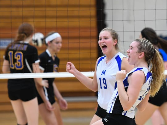 Memoral's Emily Weinzapfel (left) and Lauren Lively react to a play as the Castle Knights play SIAC rival Memorial at Memorial Tuesday evening, September 20, 2016.