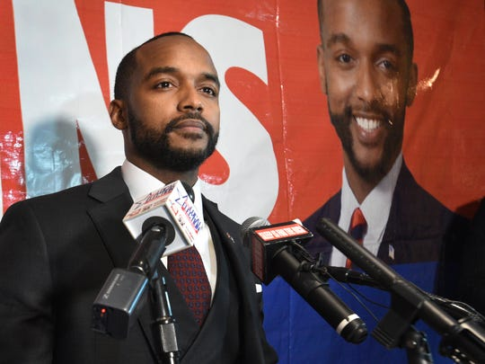 Adrian Perkins speaks to his supporters after winning