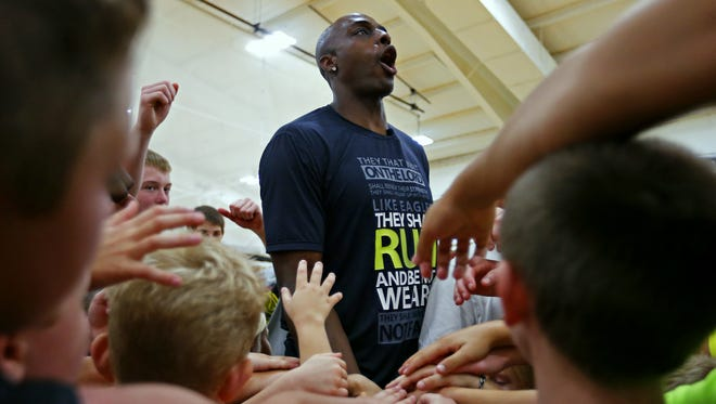 Springfield native and NBA player Anthony Tolliver huddles up with the kids attending his annual basketball camp at the Courts E-Zone on June 16, 2015.
