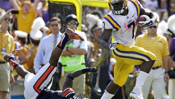 LSU running back Leonard Fournette runs over Blake
