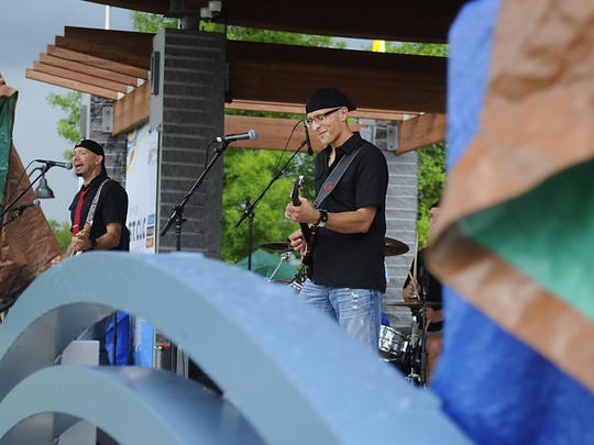 The band Southbound plays through the rain at Summertime by George! on July 15 at Lake George.