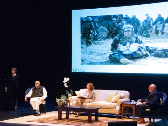 Molly Bingham, far left, showed a photo from Iraq as