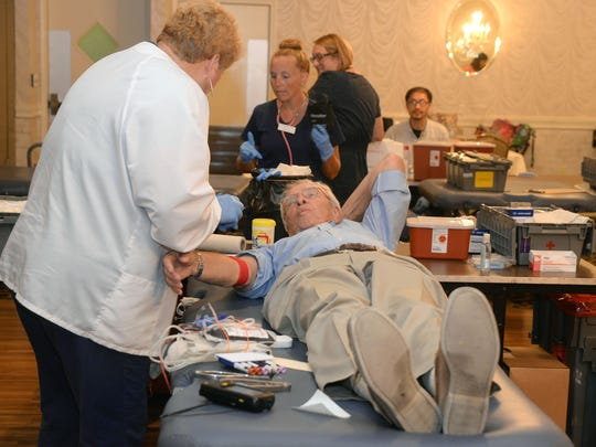 Ron McMahon of Vineland, donates blood with phlebotomist Nitza Juarbe of Somers Point (left), Tuesday, Jul. 14, 2015 in Vineland. Staff Photo/Sean M. Fitzgerald