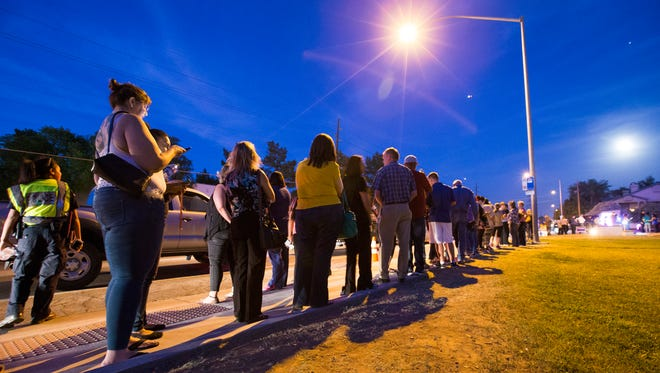 Voters wait in line to cast their ballots at Pilgrim Evangelical Lutheran Church in Mesa on March 22, 2016. Lines in the evening were around three hours.