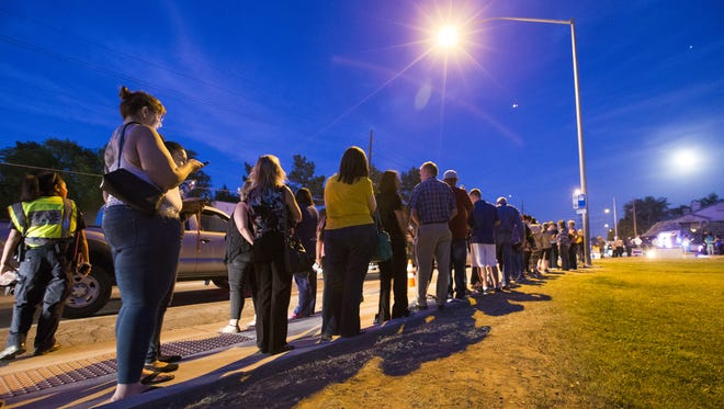 Voters wait in line to cast their ballots at Pilgrim Evangelical Lutheran Church in Mesa March 22, 2016. Lines in the evening were around three hours.