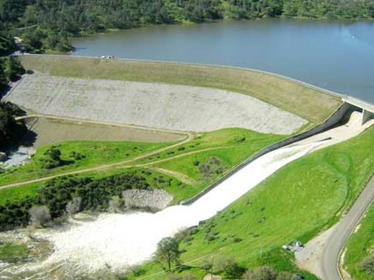 An aerial view shows Lake Nacimiento Dam releasing excess water.