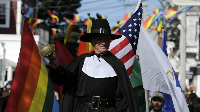 "Town crier Ken Lonergan kicks off Provincetown's 36th Annual Carnival parade in 2014. Lonergan will hang up his Pilgrim costume and retire after 13 years. ""Provincetown without Ken and his bell is a strange thought,"" friend Mike Syers said. ""Ken is an important part of our present-day history."""