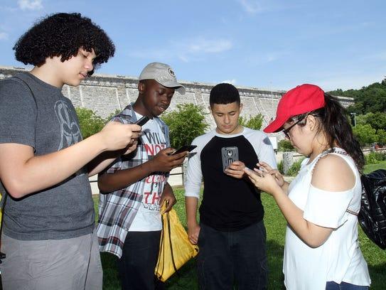 Colin Regan, 16, left, Tyler Venzen, 16, Andres Espinoza,