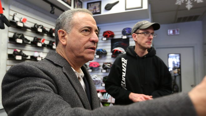 Russ Feingold, candidate for U.S. Senate, talks to Heavy Pedal Bicycles owner Dan Holsen during his campaign trip in Manitowoc County on Thursday, Feb. 18.