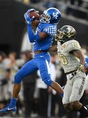 Kentucky cornerback Derrick Baity (8) pulls in a interception over Vanderbilt wide receiver Trent Sherfield (10) during the first half at Vanderbilt Stadium Saturday, Nov. 11, 2017 in Nashville, Tenn.