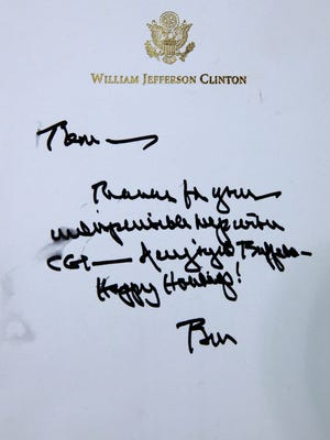 A handwritten note to Tom Golisano from former president Bill Clinton.
