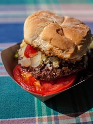 A cheeseburger made with 1/3 pound of grass-fed beef