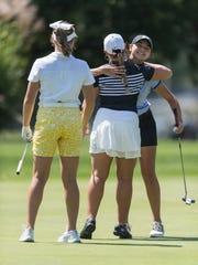 Central's Alyssa Dardeen (left to right) waits as North's Hadley Walts and Memorial's Mallory Russell hug after finishing on hole nine and as Alyssa Dardeen waits to in the SIAC Girls City Golf tournament at McDonald Golf Course in Evansville, Ind., on Saturday, Sept. 9, 2017.