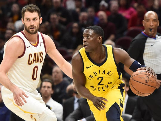 Jan 26, 2018; Cleveland, OH, USA; Indiana Pacers guard Darren Collison (2) moves to the basket against Cleveland Cavaliers forward Kevin Love (0) during the first half at Quicken Loans Arena. Mandatory Credit: Ken Blaze-USA TODAY Sports
