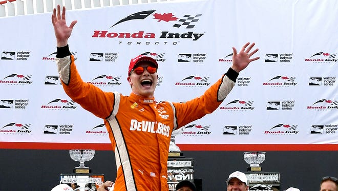 Jul 16, 2017; Toronto, Ontario, CAN;  Verizon IndyCar series driver Josef Newgarden (2) celebrates in Victory Lane after winning the Honda Indy Toronto at Streets of Toronto.