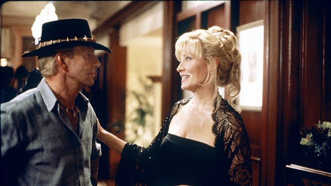 Linda Kozlowski and Paul Hogan in a scene from the film 'Crocodile Dundee'.