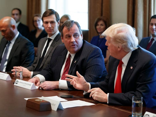 President Donald Trump speaks to Gov. Chris Christie in March.