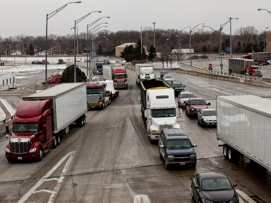 Traffic travels across the eastbound span of the Blue Water Bridge in March 2015. MDOT is considering increasing the toll for eastbound motorists paying with Canadian currency from $3 Canadian to $3.75.