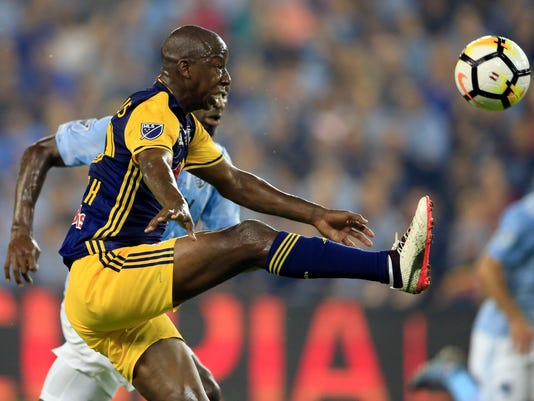 New York Red Bulls forward Bradley Wright-Phillips handles a pass against a Sporting Kansas City defender during the first half in the finals of the U.S. Open Cup soccer tournament in Kansas City, Kan., Wednesday, Sept. 20, 2017. (AP Photo/Orlin Wagner)