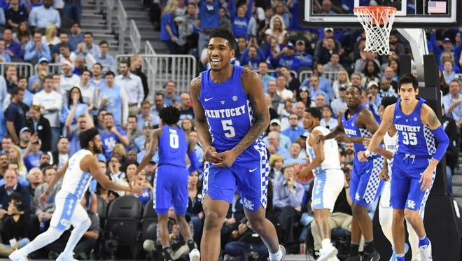 Kentucky guard Malik Monk (5) smiles after scoring a three-point basket against North Carolina.