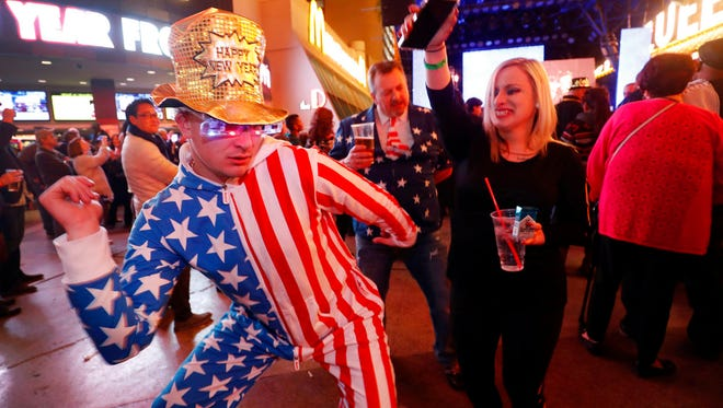Eric Loeding of Onalska, Wisc., dances during a New Year's Eve party at the Fremont Street Experience in downtown Las Vegas, Sunday, Dec. 31, 2017.