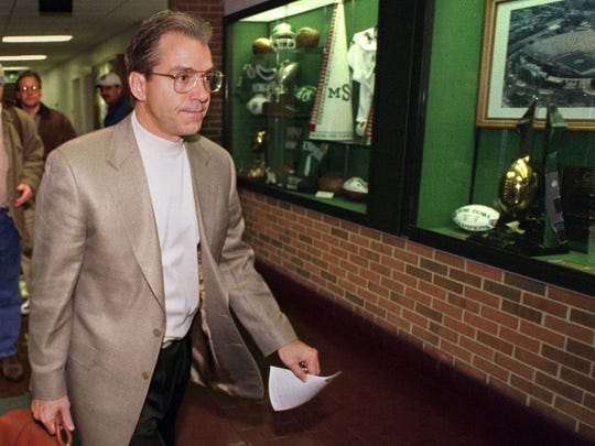 MSU head football coach Nick Saban walks past a row of trophy cases as he leaves the Duffy Daugherty Football building on his way to Louisiana, where he has accepted the head coaching job at Louisiana State University.