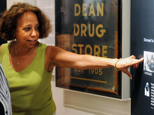 Valda Harris Montgomery points to a photo of her father Richard Harris, owner of Dean Drug Store, Tuesday, Aug. 5, 2008, at the Troy University Rosa Parks Library and Museum in downtown Montgomery. The Harris family donated signage from the drug store which was located on Monroe Street during the days of the bus boycott and civil rights movement.