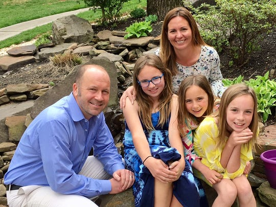 Lisa Plawchan, upper right, and her family. Plawchan's three daughters attend Knox County schools.