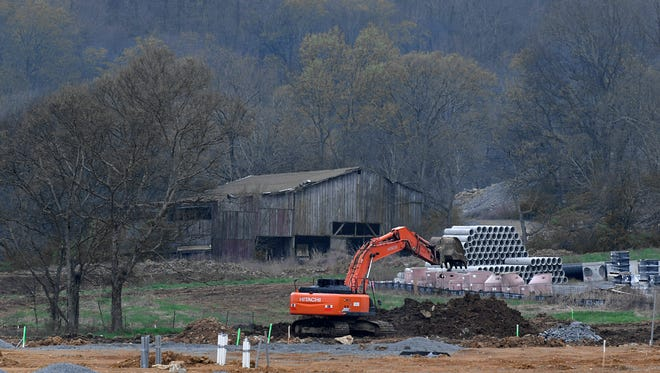 A barn is the background to construction work for new homes Westhaven in Franklin on Monday, April 2, 2018.