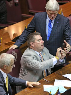 Representative Kevin Mahan gets help with a photos with colleagues on Organization Day at the Indiana Statehouse, Tuesday, November 22, 2016.