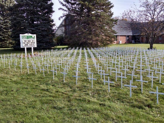 Crosses placed on the lawn of Faith Bible Church in