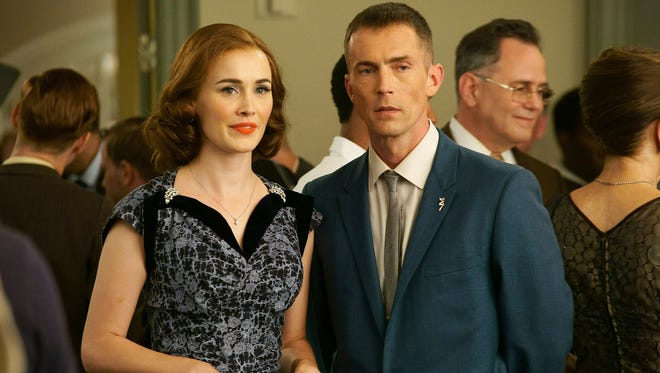 "Dominique McElligott as Louise Shepard (L) and Desmond Harrington as Alan Shepard in ABC's ""The Astronaut Wives Club."""