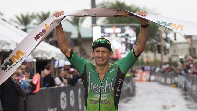 Lionel Sanders crosses the finish line, winning the Ironman Arizona triathlon in Tempe November 15, 2015.