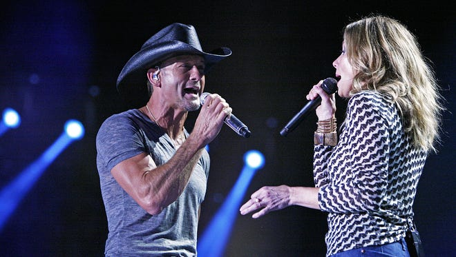 Tim McGraw performs with his wife Faith Hill during the CMA Fest at LP Field June 5, 2014, in Nashville.