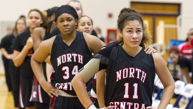 North Central junior Taylor Ramey (11) and her teammates react to their loss of the IHSAA 4A Girls' Basketball Tournament Regional championship game, Saturday at Decatur Central High School.