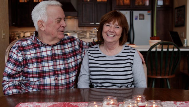 In this Jan. 31, 2017 photo, Rick and Nina Schmidt sit at the table of their home in Hartland, Wis. Nina Schlidt was diagnosed with chronic myelogenous leukemia in 2009 and had to take drugs to control it for six years.