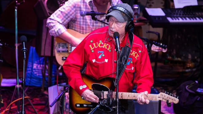 "In this May 7, 2016 photo, Russ Ringsak, longtime truck driver for Garrison Keillor's ""A Prairie Home Companion"" public radio variety show, plays a song as a farewell on his final show of the tour at the Ryman Auditorium in Nashville, Tenn.  Ringsak died Tuesday, Oct. 3, 2017 at his home in Stillwater, his wife, Denise Ringsak, told Keillor's Prairie Home Productions."