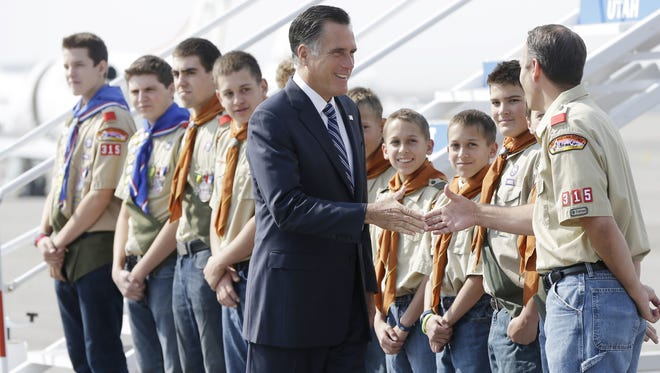 Republican presidential candidate and former Massachusetts Gov. Mitt Romney greets boy scouts as he arrives in Salt Lake City, Utah, Sept. 18, 2012.