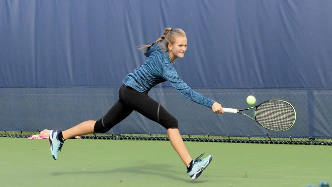 Morgan Coburn of Indian Hill shows off her backhand prowess at the 2016 OHSAA State Tennis Tournament, October 21.