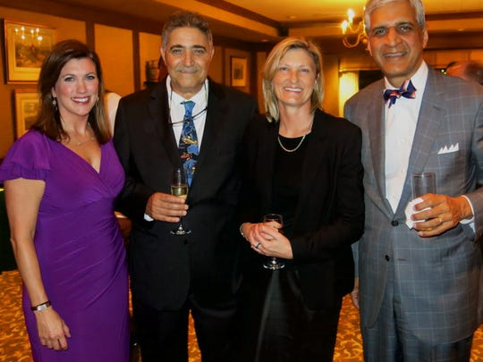 Dr. Christina Notarianni (far right) and Dr. Anil Nanda (far left) greet Dr. Yigal Shoshan, of Jerusalem, and Dr. Kate Drummond, of Melbourne, at neurosurgery reception.