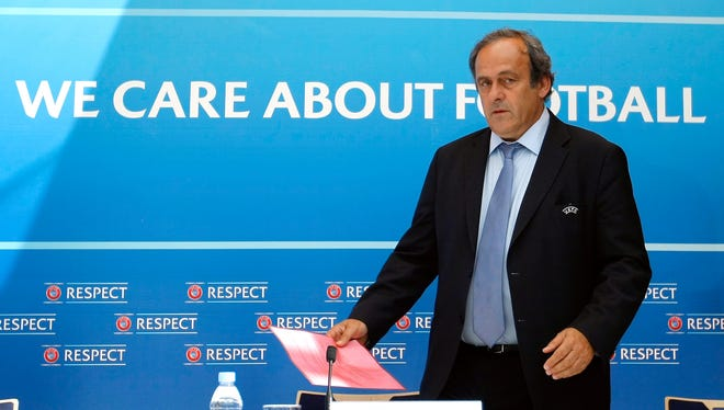 FILE - On Oct. 8, 2015 FIFA provisionally banned UEFA President Michel Platini for 90 days.