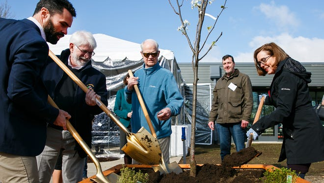 (Left to right) Eric Paine with Community Development Partners, Mayor Chuck Bennett, Senate President Peter Courtney and Gov. Kate Brown plant a pear tree in the community gardens of Fairhaven Gardens apartment complex at the grand opening on Monday, April 2, 2018, in Salem.