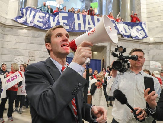 Attorney General Andy Beshear speaks to the crowd as