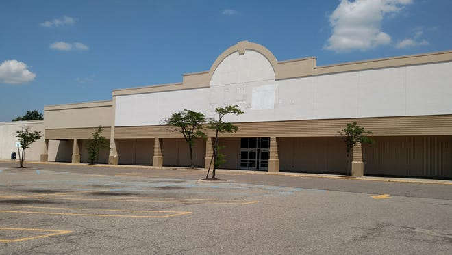 The building that used to house Kmart at Seven Mile and Farmington in Livonia. A citizens group claims Kroger and Applebees could head to the site, while property owners Schostak Bros., say new tenants have not been confirmed.