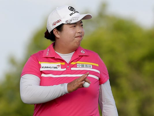 China's Shanshan Feng reacts after sinking a putt on the 17th green during the third round of the U.S. Women's Open golf tournament Saturday, July 15, 2017, in Bedminster, N.J. (AP Photo/Seth Wenig)