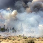 In this July 13, 2014, photo released by the Oregon Department of Forestry, the Moccasin Hill fire burns north of Sprague River and northeast of Klamath Falls, Ore.