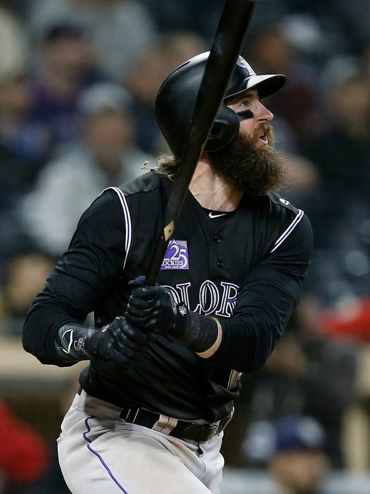 Colorado Rockies' Charlie Blackmon hits a solo home run against the San Diego Padres during the ninth inning of a baseball game in San Diego, Monday, April 2, 2018. (AP Photo/Alex Gallardo)